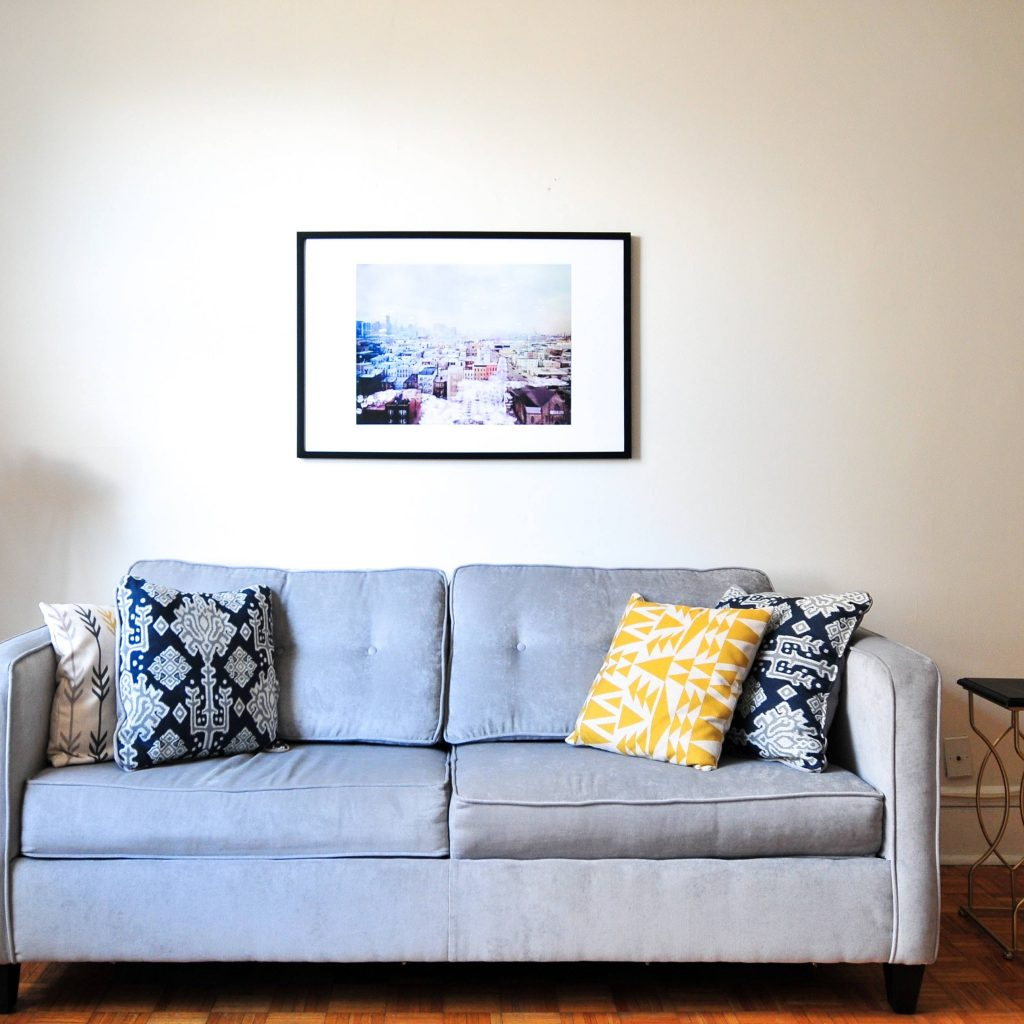 Go big with a couch in Ultimate Grey. Add a pop of color with a throw pillow in Illuminating.